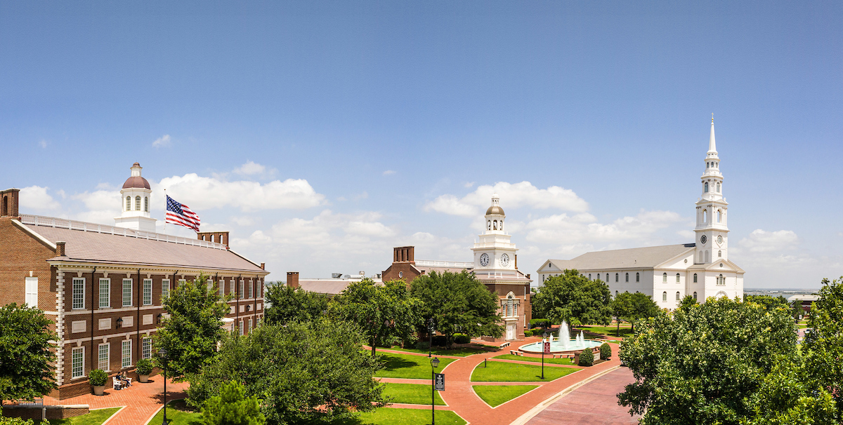 Panoramic picture of the beautiful DBU campus showing Blackaby Hall, Mahler Student Center and Pilgrim Chapel