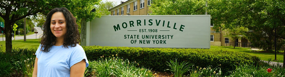 Student with Morrisville Sign