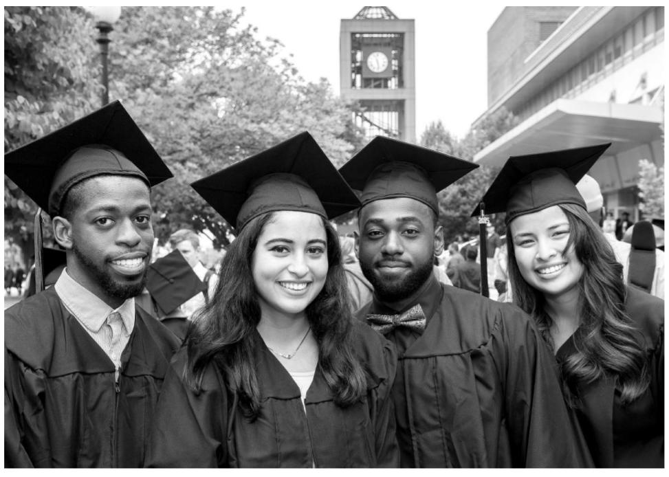 Image of Four QNS College Graduates.