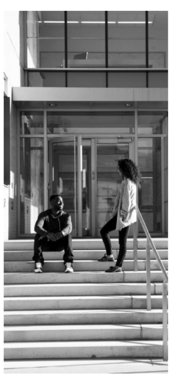 QNS Image of Two Students Sitting on Staircase.